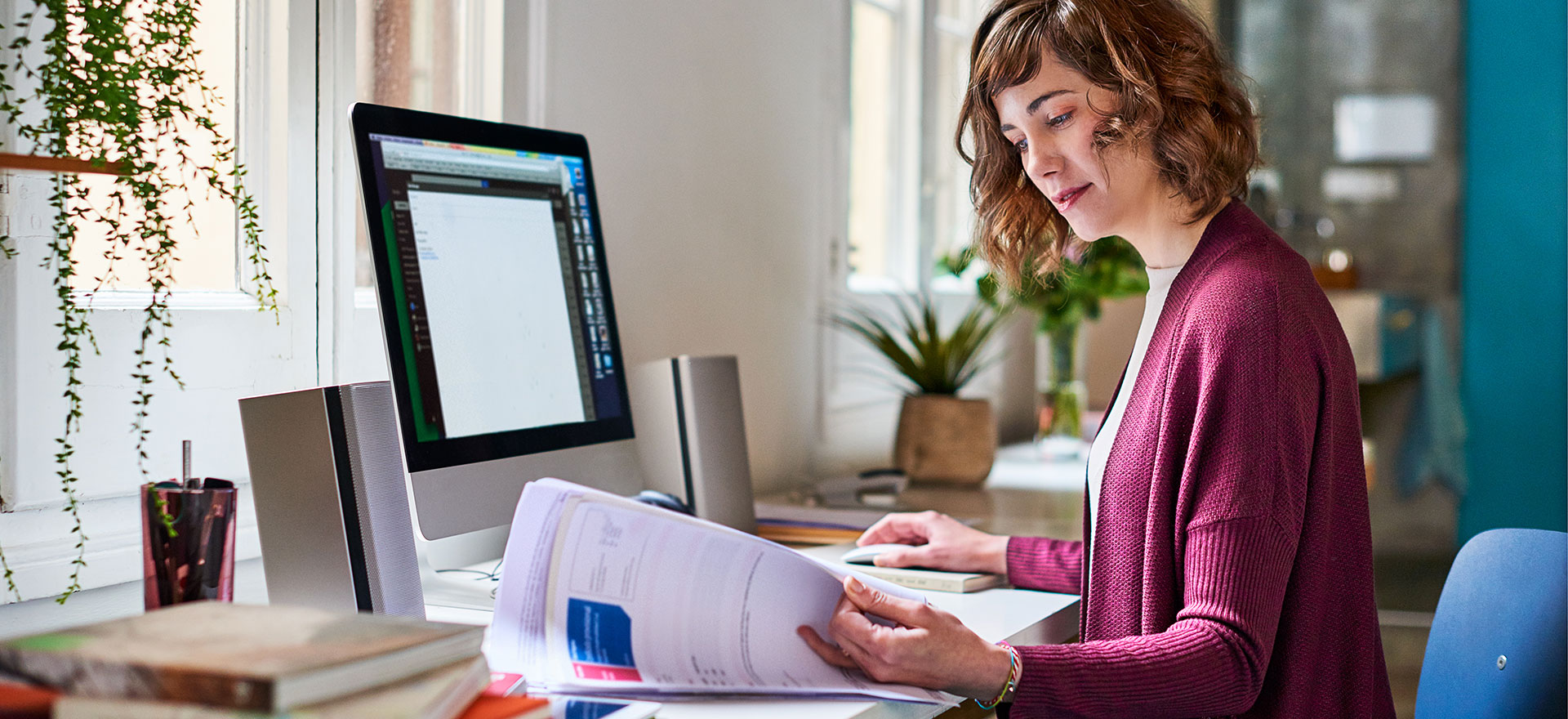 woman at desk choosing between debt finance and equity finance