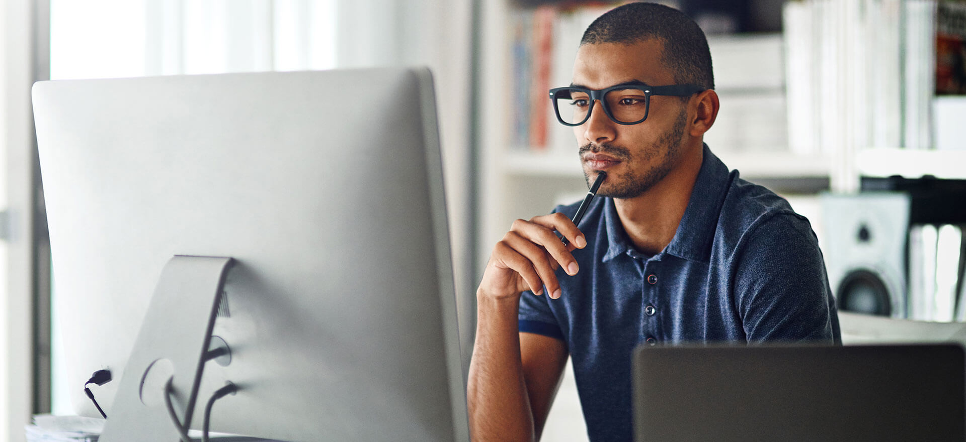 Man at computer comparing business credit card options