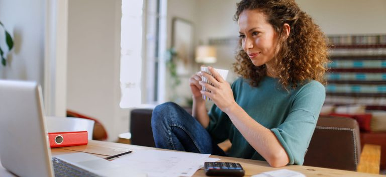 Woman At Computer Writing A Business Plan.