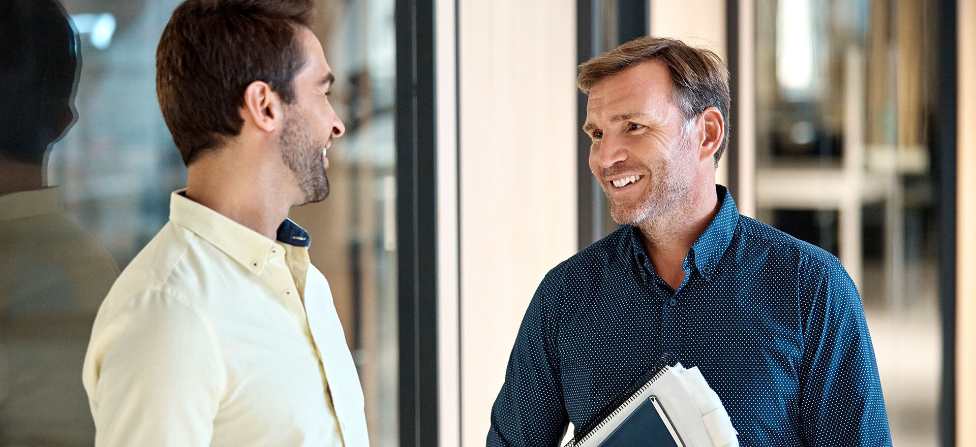Two business people discussing hiring an accountant