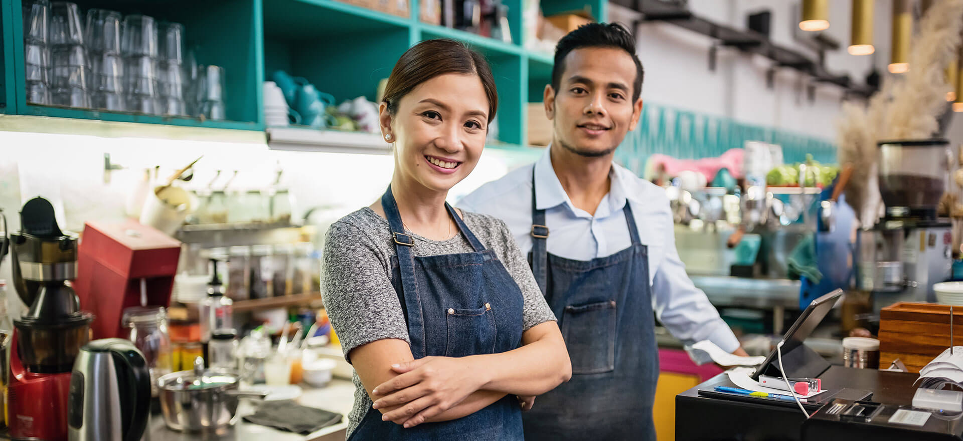 Small business owners in their cafe.