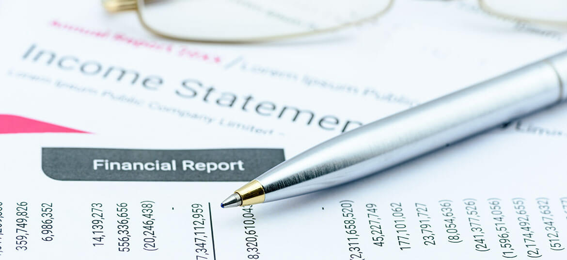 showing income statement with pen
