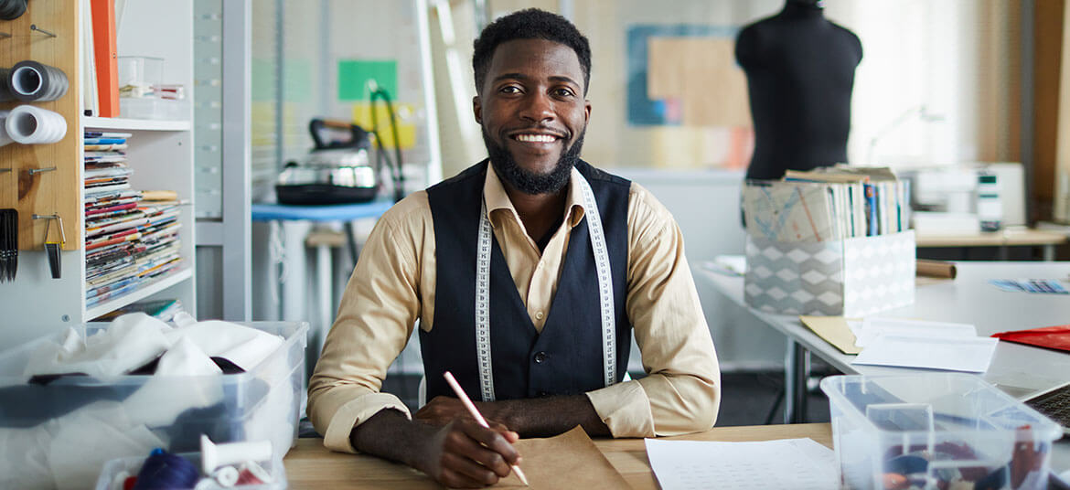 Man calculating gross profit and net profit for his small business