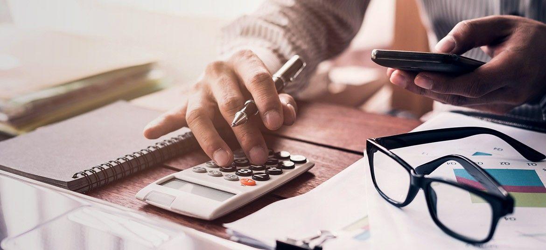 person at desk managing accounts receivable