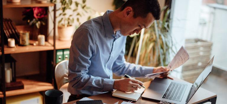 Man At Computer Considering Trade Credit