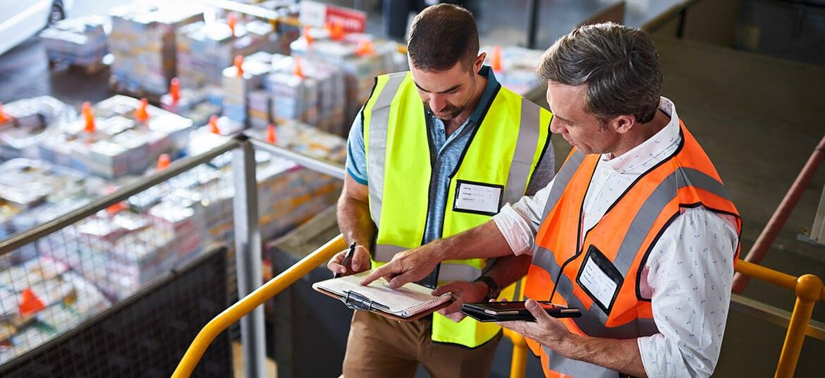 two men in warehouse considering trade finance options