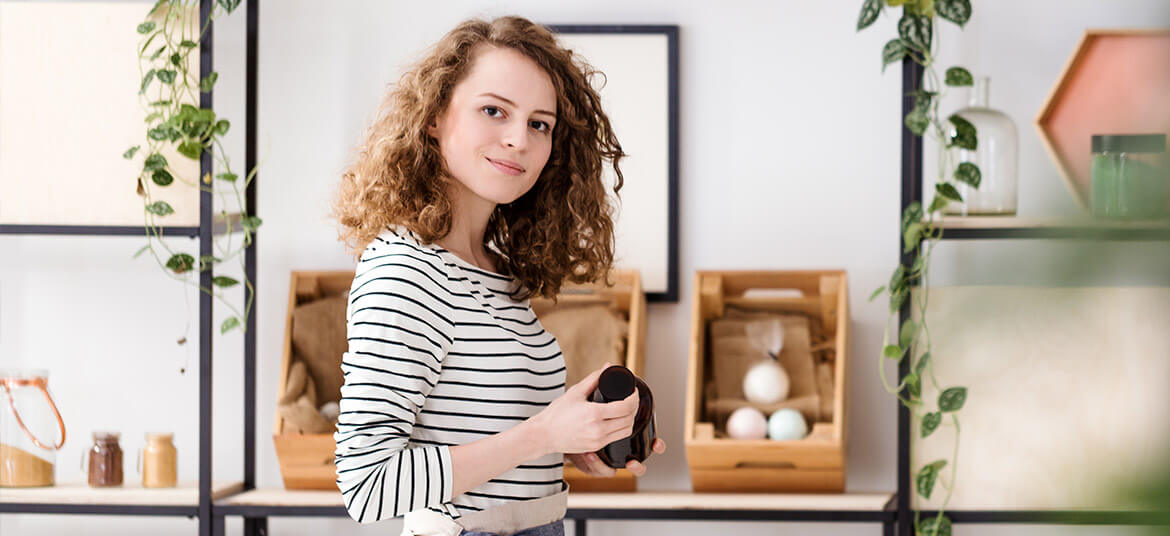 woman in retail shop thinking about the cash conversion cycle