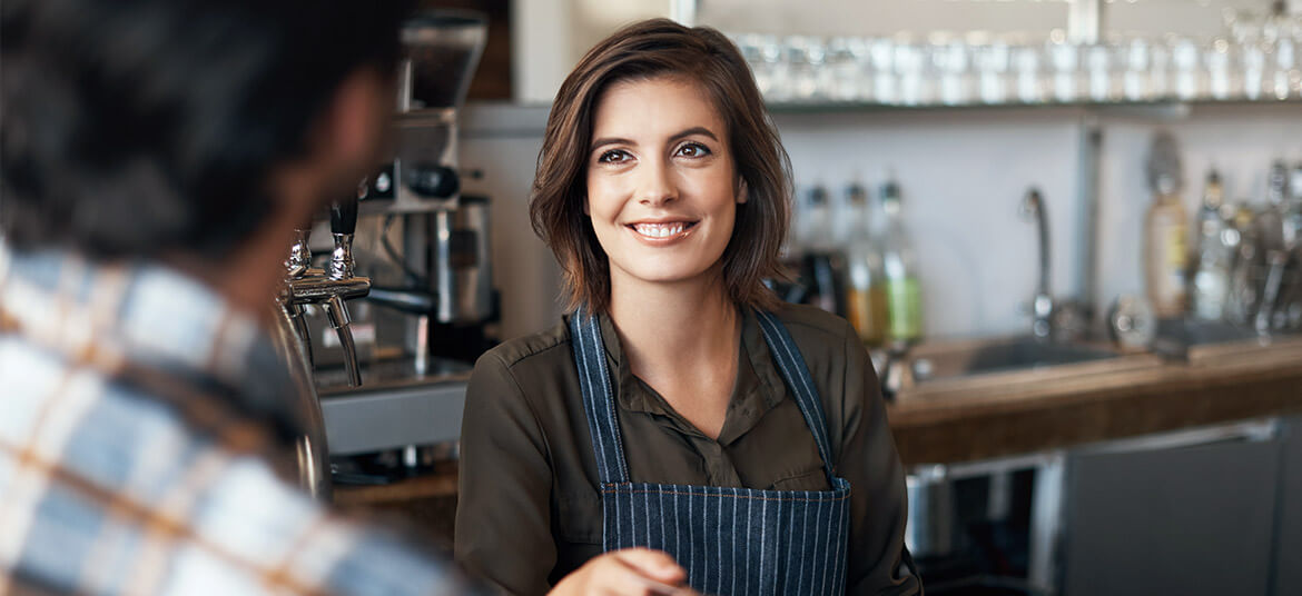 hospitality worker at bar discussing the Australian minimum wage