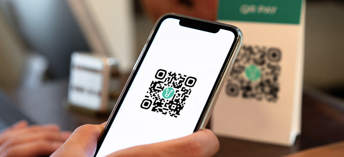 a person using a QR code for business